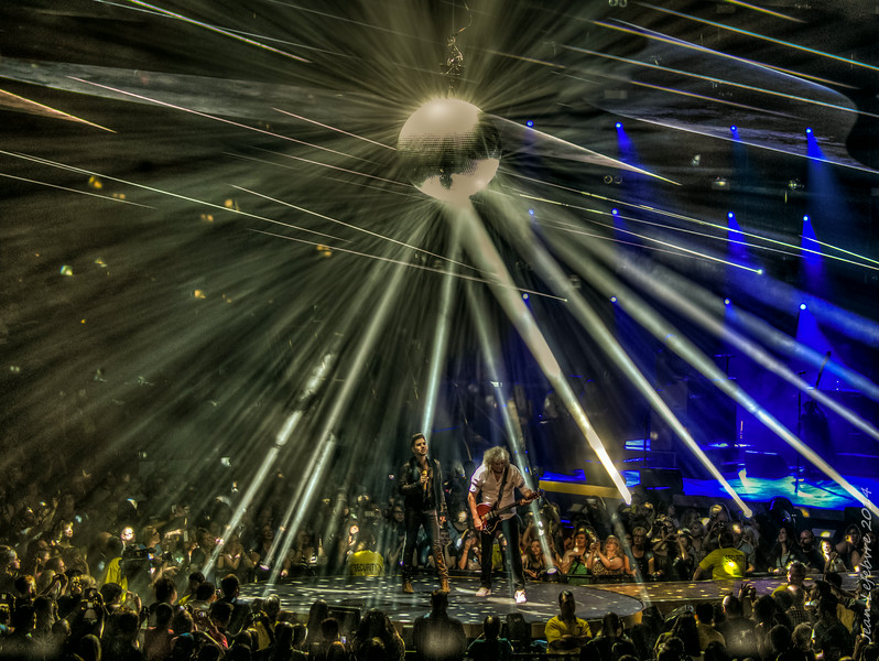 Adam Lambert, Brian May, and disco ball