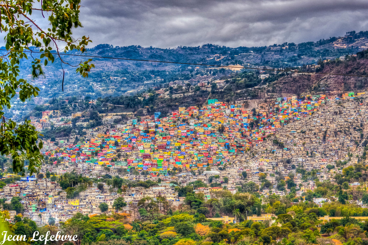 In the distance is Port au Prince's Jalousie neighbourhood --> painted to give this land a splash of color that mirrors it's peoples spirit.