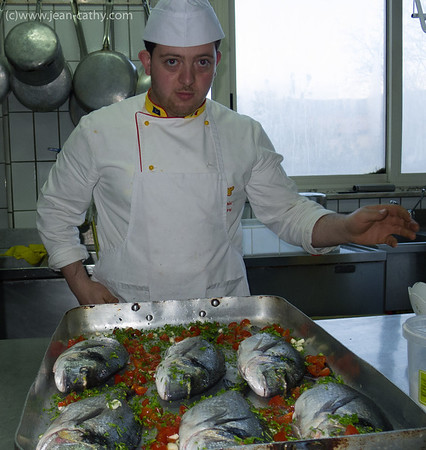 Chef with prepared sea bream