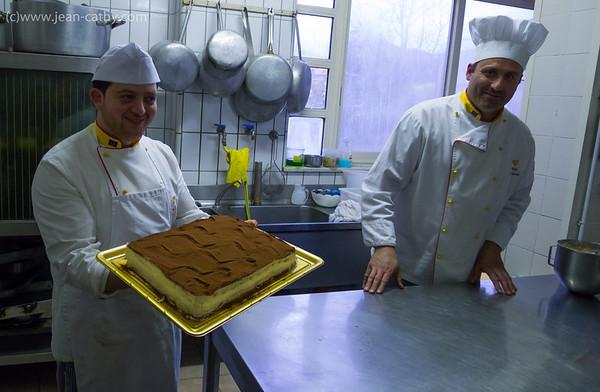 Chefs with tiramisu